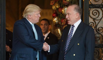FILE PHOTO: Donald Trump shakes hands with Ronald Lauder, President of the World Jewish Congress, after a meeting. December 28, 2016 at Mar-a-Lago in Palm Beach, Florida.
