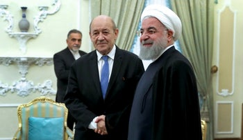 Iranian President Hassan Rouhani, right, welcomes French Foreign Minister Jean-Yves Le Drian at the start of their meeting, in Tehran, Iran, Monday, March 5, 2018