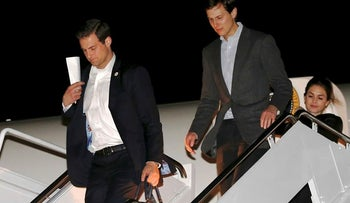 U.S. President Trump's personal aide John McEntee (L) deplanes with White House senior advisor Jared Kushner as they return with Trump from a weekend at his New Jersey golf estate home via Air Force One at Joint Base Andrews, Maryland, U.S. May 7, 2017