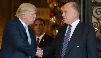 Donald Trump shakes hands with Ronald Lauder, President of the World Jewish Congress,  after a meeting at Mar-a-Lago in Palm Beach, Florida on December 28, 2016.