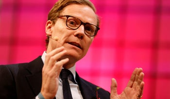 FILE PHOTO: CEO of Cambridge Analytica, Alexander Nix, speaks during the Web Summit, Europe's biggest tech conference, in Lisbon, Portugal, November 9, 2017. REUTERS/Pedro Nunes/File Photo