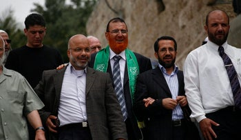 Mohammed Abu Tir (center, with green scarf) after he is released from jail in 2010. He is one of four Hamas men who could lose their legal status along with Ahmed Atoun, Mohammed Totah and Khaled Abu Arafeh
