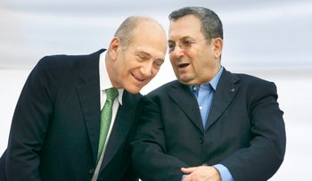 Then-Defense Minister Ehud Barak, right, in conversation with Prime Minister Ehud Olmert in July 2007, a month after the attack on the Syrian nuclear reactor.