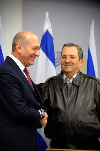 Ehud Olmert and Ehud Barak in 2009. One of these men is seemingly already imagining how he will describe this meeting in his memoir.