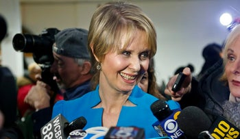 Candidate for New York governor Cynthia Nixon speaks with reporters at her first campaign stop, Tuesday March 20, 2018.