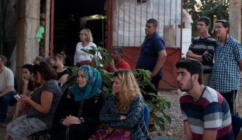 A meeting between Palestinians and Israeli settlers in Gush Etzion in the West Bank, July 5, 2015.