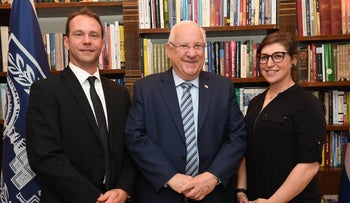 Actress Mayim Bialik, right, with Israeli President Reuven Rivlin, center, and her partner at the president's residence in Jerualem, March 18, 2018.