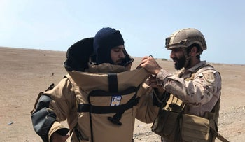 FILE PHOTO: A member of the UAE armed forces is getting ready before searching for landmines in Yemen, March 6, 2018.