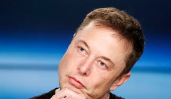FILE PHOTO: SpaceX founder Elon Musk  at a press conference following the first launch of a SpaceX Falcon Heavy rocket at the Kennedy Space Center in Florida, February 6, 2018.