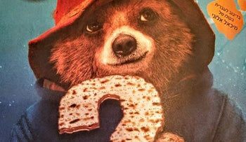 """Paddington holding a matza on Israeli billboards. Some would call it """"religious coercion"""" and """"religionization"""", some would dismiss the changes with a laugh."""