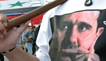 A picture of Syrian President Bashar al-Assad is seen on a Syrian man's T-Shirt in Damascus December 11, 2005.