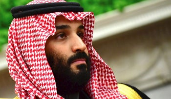 Mohammed bin Salman, Saudi Arabia's crown prince, listens during a meeting with U.S. President Donald Trump, not pictured, in the Oval Office of the White House in Washington, D.C., U.S., on Tuesday, March 20, 2018