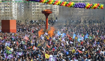 People chant slogans during the Newroz celebrations, marking the start of spring, in Istanbul, Wednesday, March 21, 2018.