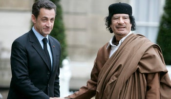 File photo: Former French President Nicolas Sarkozy and the late Libyan leader Moammar Gadhafi during a 2007 meeting in the Elysee Palace.