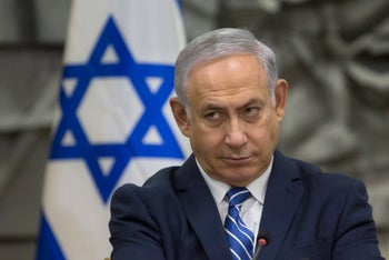 Israeli Prime Minister Benjamin Netanyahu attends a special cabinet meeting in the southern Israeli city of Dimona on Tuesday, March 20.