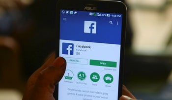 This photo illustration taken on March 22, 2018 shows apps for Facebook and other social networks on a smartphone in Chennai