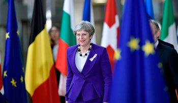Britain's Prime minister Theresa May arrives on the first day of a summit of European Union (EU) leaders at the EU headquarters in Brussels, on March 22, 2018.