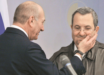 Then-Prime Minister Ehud Olmert jokes with Defense Minister Ehud Barak at a press conference following a meeting of the security cabinet in Tel Aviv, Jan. 17, 2009.