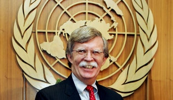 John Bolton smiles during a meeting at the UN headquarters in New York August 2, 2005