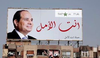 """A election banner for Egyptian President Abdel-Fattah el-Sissi hangs on top of a residential building that reads """"You are the hope"""" in Cairo, Egypt on March 24, 2018."""
