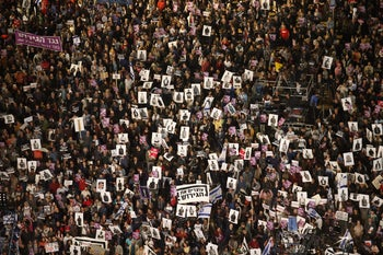 25,000 people rally in Tel Aviv in protest of expulsion of African asylum seekers from Israel, March 24, 2018.