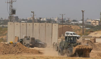 Military vehicles are seen near Israel's border with Gaza, March, 2018.