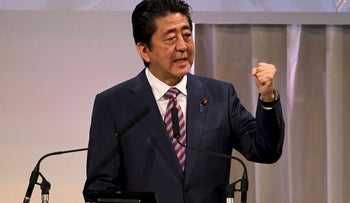 Japan's Prime Minister and ruling Liberal Democratic Party (LDP) leader Shinzo Abe delivers his speech at his party convention in Tokyo on March 25, 2018