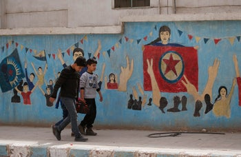 Syrian children carrying food walk in the northwestern city of Afrin, Syria, during a Turkish government-organised media tour into northern Syria. March 24, 2018