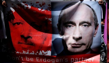 A banner showing Turkey's President Erdogan and Russian President Putin during a protest against the Turkish offensive targeting Kurds in Afrin, Syria outside the U.S. embassy in Nicosia, Cyprus. March 12, 2018