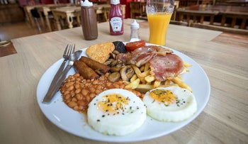 The 'Super' full English breakfast sits at the 'Enough to Feed an Elephant' cafe in this arranged photograph in London, U.K., on Monday, July 10, 2017