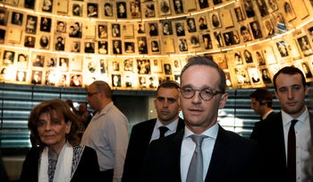 German Foreign Minister Heiko Maas (R) and holocaust survivor Charlotte Knobloch (1st-L) leave the Hall of Names in Yad Vashem on March 25, 2018