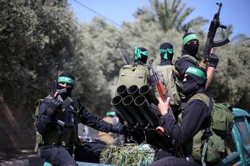 Palestinian Hamas militants attend a military drill in preparation to any upcoming confrontation with Israel, in the southern Gaza Strip March 25, 2018.
