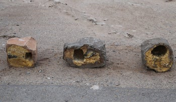 Three explosives disguised as rocks in Yemen. Undated photograph provided by Conflict Armament Research, an independent London-based group that researches battlefield weaponry