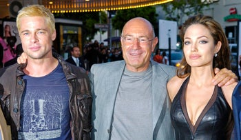 """Arnon Milchan, with Brad Pitt and Angelina Jolie, as they arrive for the premiere of """"Mr. & Mrs. Smith"""" in Los Angeles on June 7, 2005."""