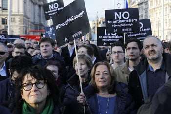 Members of the Jewish community hold a protest against Britain's opposition Labour party leader Jeremy Corbyn and anti-semitism in the  Labour party, March 26, 2018