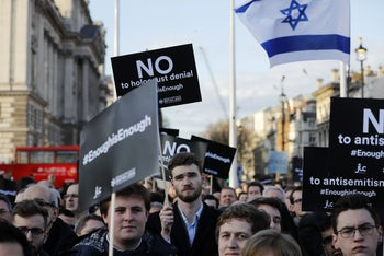 British Jews at a protest against Britain's opposition Labour Party leader Jeremy Corbyn and anti-Semitism in the party, outside the Houses of Parliament, London, March 26, 2018.