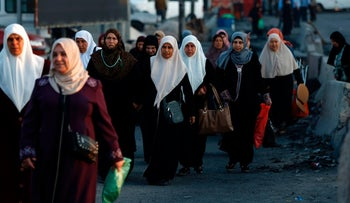 Palestinian women crossing into Israel from the West Bank