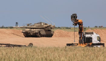 An Israeli tank securing work near the border with Gaza, March 25, 2018.