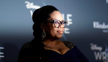 """Cast member Oprah Winfrey poses at the premiere of """"A Wrinkle in Time"""" in Los Angeles, California, U.S., February 26, 2018."""