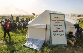 Palestinians gather next to tents they erected near the Gaza-Israel border on the outskirts of Gaza City, for a six-week show of support for Palestinian refugees. March 27, 2018
