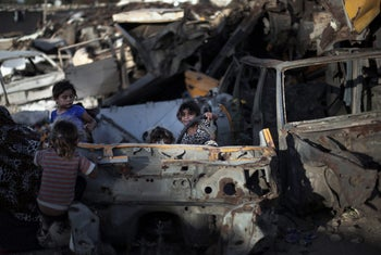 Poverty in Gaza: Palestinian children play among discarded vehicles in el-Zohor slum, on the outskirts of Khan Younis refugee camp, southern Gaza Strip.