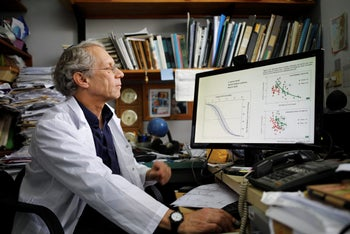 Dr. Shabtai Cohen looks at his computer during an interview, in his office at the Volcani Agricultural Research Centre in Beit Dagan, Israel, March 8, 2018.