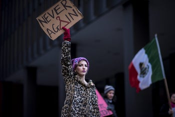 """A demonstrator holds a """"Never Again"""" sign during the second annual Women's March Chicago in Chicago, Illinois, U.S. Jan. 20, 2018"""