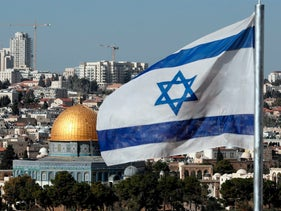 The Israeli flag flutters in front of the Dome of the Rock mosque and the city of Jerusalem, on December 1, 2017