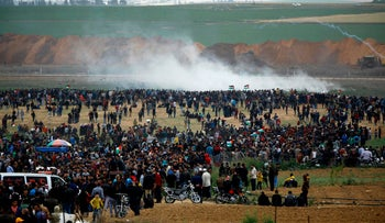 Palestinians take part in a tent city protest near the border with Israel east of Jabalia in the northern Gaza strip on March 30, 2018