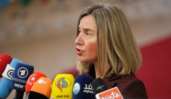 European Union foreign policy chief Federica Mogherini speaks with the media as she arrives for an EU summit at the Europa building in Brussels, March 22, 2018.