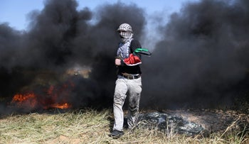 A Palestinian in clashes with Israeli troops during a rally at the Gaza-Israel border, March 31, 2018.