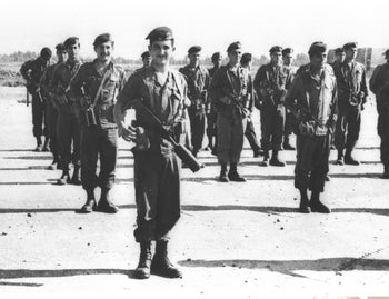 Barak as a young commander during an army inspection.