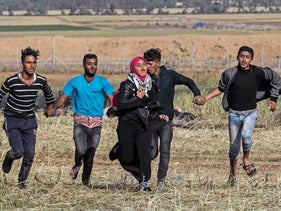 Palestinian protesters east of Khan Yunis, Gaza, on March 31, 2018