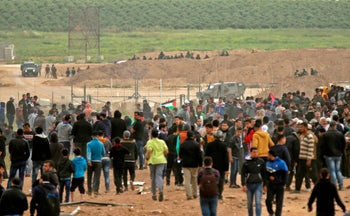 A picture taken on March 30, 2018 shows Palestinians taking part in a demonstration commemorating Land Day near the border with Israel east of Gaza City.